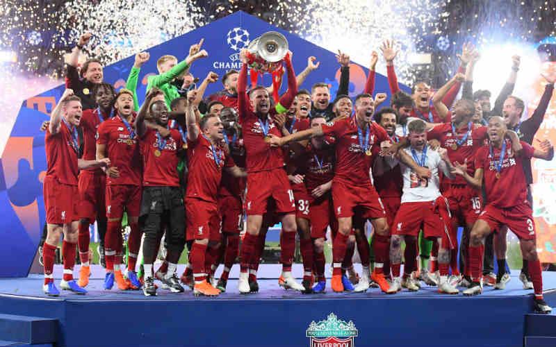Liverpool captain Jordan Henderson lifts Champions League trophy last summer