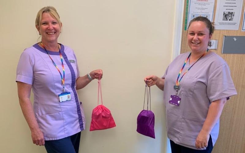 Jane Richardson and Janine Tidyman (L-r), of Loomer Road Surgery and Haymarket Health Centre with grab bag